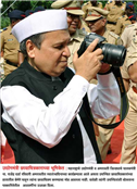 LOVE FOR PHOTOGRAPHY. Industry Minister Rajendra Darda caught in camera while shooting a snap. Amravati, 2010.