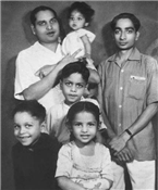 Rajendra Darda with cousins (in black, smiling).